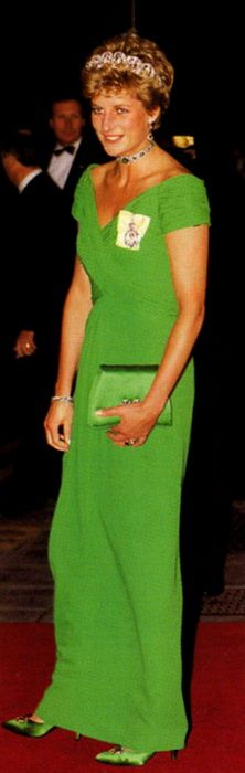 A grass-green silk georgette dress designed by Catherine Walker worn by Diana to an official banquet at the Dorchester Hotel in London.  She wore it with emeralds (the famous emerald choker that she wore as a headband), a green satin purse and green satin shoes with jeweled buttons on the toes.