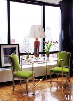 A circa-1960 French games table offers a modest dining surface in Todd Alexander Romano's New York pied- -terre. The 18th-century chaises la reine are covered in parrot-green velvet from Old World Weavers.  DESIGNER: Todd Alexander Romano PHOTOGRAPHER: Thomas Loof