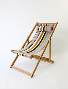 REMOVABLE 100% Cotton sling and pillow.  Grey, bright pink, chartreuse and brown striped fabric comes with matching pillow on deluxe white oak frame with 2 white oak dowels to hold fabric in place. Each fabric sling and pillow is custom made. The pillow inner is made out of 100% North American organic cotton.