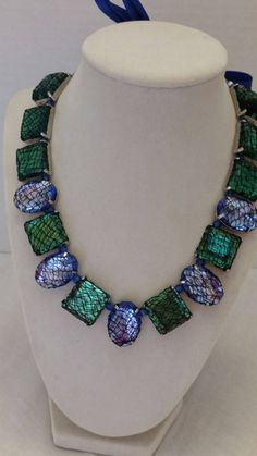 Check out this item in my Etsy shop https://www.etsy.com/listing/203019462/jeweled-necklace-fishnet-necklace-blue