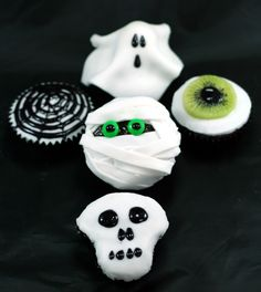 Halloween Cupcakes by Mary-Anne Boermans. All you need is a block of fondant and a black gel pen! http://timetocookonline.com/2011/10/29/halloween-cupcakes/  #Halloween #HalloweenLDN