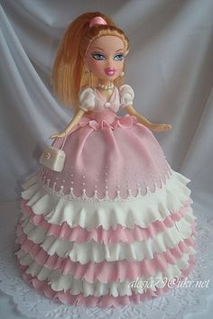 BRATZ DOLL CAKE with beautiful white and pink ruffles on the dress