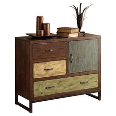 Wood and metal chest with three drawers and one door in complementing colors.      Product: Chest  Construction Material: ...
