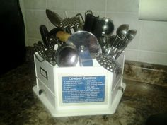 Just luv this idea! Michaels craft carousel for organizing kitchen utensils.....it even has a photo pocket for my recipes!
