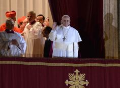 The new Pope Jorge Mario Bergoglio appears at the window of St. Peters Basilicas balcony after being elected the 266th pope of the Roman Catholic Church on March 13 at the Vatican. (Photo: Filippo Monteforte / AFP - Getty Images) #NBCPope