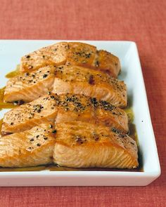 Soy-Glazed Salmon; Ingredients ;  1/4 cup packed light-brown sugar  ,1/4 cup olive oil ,3 tablespoons soy sauce  2 tablespoons fresh lemon juice  2 tablespoons dry white wine, or water  2 pounds salmon fillet,Lemon wedges, for serving .#Preheat oven to 400 degrees # baking dish, 15 to 20 minutes. Serve with lemon wedges.
