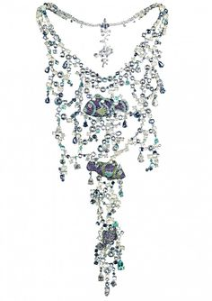 Chopard A SCINTILLATING FISH NECKLACE LIMITED EDITION The school of gem-set tropical fish swimming through the shimmering moonstone-lit sea.