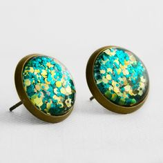 Electric Glitter Post Earrings in Antique Bronze - Turquoise Blue... ($10) ❤ liked on Polyvore featuring jewelry, earrings, holiday earrings, yellow earrings, turquoise jewelry, nickel free earrings and turquoise post earrings