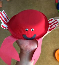 Paper bowl crab craft for kids to make using their handprints as the legs! | CraftyMorning.com