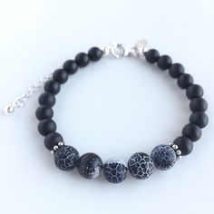 Handmade bracelet with genuine matte onyx and five black frosted crackled fire agate gemstone beads, details in 925 sterling silver by Penello on Etsy https://www.etsy.com/listing/262882992/handmade-bracelet-with-genuine-matte