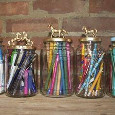 Decorative jars. gold-painted animals.