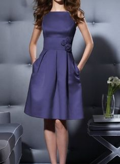 I'm not always the biggest fan of purple, but this is really tasteful. Love the flower... and POCKETS!