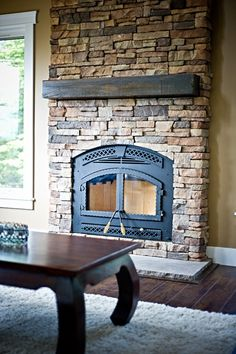 Stonewater Construction | Photos - Stone work fireplace with rustic timber mantle and slate hearth.