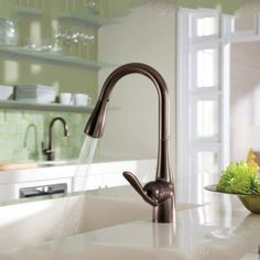 Moen Arbor One-Handle High Arc Pulldown Kitchen Faucet Featuring Reflex, Oil Rubbed Bronze in Touch On Kitchen Sink Faucets. Unpainted Furniture, Furniture Decor, Touchless Kitchen Faucet, Best Kitchen Faucets, Led, Küchen Design, Granite Countertops, Oil Rubbed Bronze, Cool Kitchens