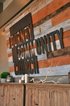 Signage concept for Lobby of church plant.  Wood with church name water-jet cut out of metal.  If we could come up with an actual name...