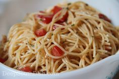 A cold spaghetti salad, made with angel hair, vermicelli or thin spaghetti, Italian dressing, fresh tomatoes and a variety of add-ins.
