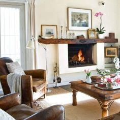 Like the neutral colors with the rich browns of mantle, chairs, table...  Beautiful Spanish home tour.