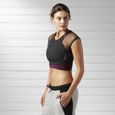 Your fun-loving fitness identity pines for playful, ego-free workouts. Pull on this LES MILLS™ crop tee for a sexy edge that keeps up with your favorite SH'BAM class. Mesh sleeves add style and function, while the elastic waistband secures the fit for serious moves.