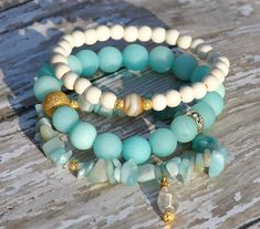 Stack of Spring Blues Beaded Bracelets / Set of 3 by BeadRustic, $55.00 love the shades of blue and aqua set off by gold with interspersed charms.