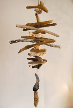 Driftwood windchime by Madeofearthandsea on Etsy