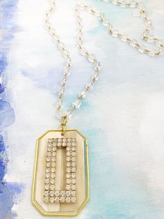 """Protector of the Faith"" - 1950's rhinestone shoe clip layered over geometric horn pendant on square lucite beaded chain"