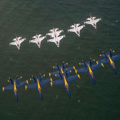 An awsome shot of two super great air Exhibtion Teams , The Blue Angles & thier fellow demo team, the USAF Thunderbirds Te