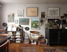 my scandinavian home: Books and a gallery wall in a fascinating, small studio where interests dictate