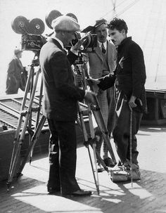 """Charlie Chaplin with camera men Rollie Totheroh & Jack Wilson. The final scenes of """"The Gold Rush"""" were shot in April 1925 aboard """"The Lark"""" """"On board was also Mack Swain & Georgia Hale. The scenes were done while the boat went its regular route..."""