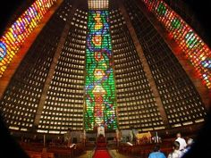 Discover Rio de Janeiro Cathedral in Rio de Janeiro, Brazil: This massive Brazilian church is built like an angular, technicolor pyramid left by Mayans from the future. Visit Rio, Temple, Stained Glass Church, Last Minute Hotel Deals, Brazil Travel, Chapelle, Vacation Places, Hotels Near, Travel Deals