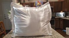 Euro pillow sham 26x26 inches with flanges for decoration envelope style satin white. Pillow sham with flange for decoration 26x26 inches does not include pillow inserts satin white envelope style Satin is good for skin and hair it is an anti aging fabric Dogs and cats hair does not stick to satin.
