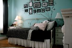 Black bedding with blue walls