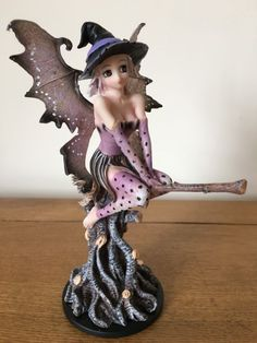 Manga fairies come from Japan where they sleep between the pages of comic books. This stunning figurine depicts a Manga Fairy witch on a broomstick and is made of resin with a hand-painted finish. A product by Nemesis Now. Appox. 17.5cm x 14.0cm. The box has a teeny bit of shelf wear and red maker on the underneath for our stock records. Please see photos.
