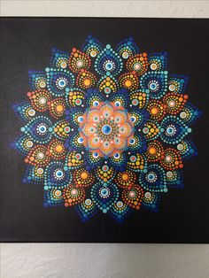 Dot Art Mandala on canvas. Hand painting with acrylic paint.