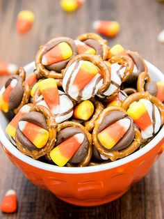 Five minutes of your time is all you need to make this candy corn-topped treat. This simple recipe is the perfect bite-size snack for a Halloween party. Pop them in the fridge after melting the chocolate for quicker setting./