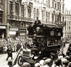 An 'Ole Bill Bus' (an LGOC B-43 type bus) taking part in the Lord Mayors Show parade in London. Thes buses were used during the First World War by the British Army to transport troops to the front, as mobile command posts  and general service and eventually to take many of them home from the front once the war had ended - 11 November 1935