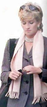 Diana, Princess of Wales in a pretty pink scarf and grey jacket.