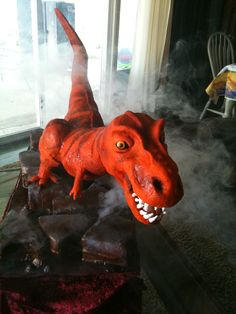 This T-Rex cake was HUGE! It was from the snout to the tip of the tail. The dinosaur is sculpted from rice cereal treats, fondant, . Dinosaur Birthday Cakes, Dinosaur Cake, Dinosaur Party, Little Boy Cakes, Cakes For Boys, Kid Cakes, Cereal Treats, Rice Cereal, T Rex Cake