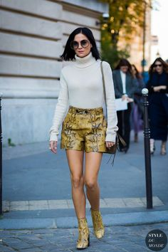 snakeskin print boots and shorts with white turtleneck sweater