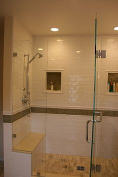 tile extends out of glass enclosed shower area.  Bench