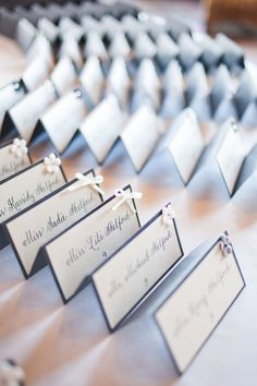 Using a small symbol (bow,flower, sticker, etc.) is a simple way to distinguish which meal a guest selected for the servers. Name Place Cards, Wedding Place Cards, Wedding Table, Wedding Favors, Wedding Reception, Wedding Invitations, Free Wedding, Our Wedding, Wedding Ideas