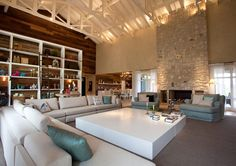 Baronesa Residence living room trusses and fireplace Farmhouse converted into rustic and luxurious villa