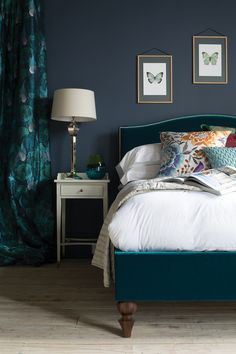Teal and dark grey. The Richmond bed by And So To Bed in teal velvet, featuring Missoni Home cushions.