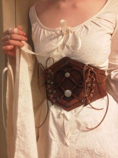 Leather and silver cincher by ~eb11