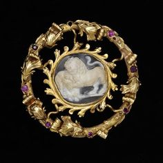 Ring brooch  Place of origin: Spain (made)  Date: 1300-1500 (made)  Artist/Maker: unknown (production)  Materials and Techniques: Gold,ruby, onyx  Museum number: 139-1879
