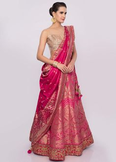 Buy Online from the link below. We ship worldwide (Free Shipping over US$100) Click Anywhere to Tag Bubblegum pink brocade lehenga set only on Kalki Bubblegum pink brocade lehenga with kali Adorn in floral and paisley motifIt has hem and waist embellished in gotta patch, resham, cord an sequins embroideryIt comes with a rose pink golden brocade unstitched blouseIts teamed up with a fuchsia pink silk dupatta with brocade butti and border