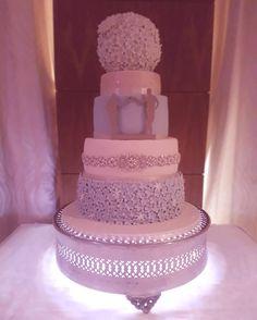 Winter Wonderland Wedding Cake.  Blue sugar ruffles,  ivory fondant, ivory daisie cake topper pomander. The Cake Lab Bakery, Ranelagh, Dublin, Ireland. Artisan Baking Studio.