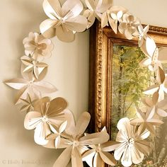 The flowers on this wreath are made out of plain white card-stock, then spray-painted with Krylon Brushed Metallic Satin Champagne Nouveau. Total cost to make this wreath: $7.