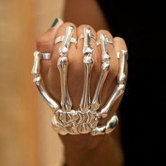 Want to look like a real badass with some badass jewelry? This skeleton hand wraps around your wrist and each finger has a ring. Stretches to fit your hand. - $15.00