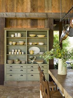 Love the wood walls in this country kitchen!