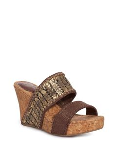 Shine and sparkle, our cork wedge features metallic gold or silver leather details with exotic straw texture.